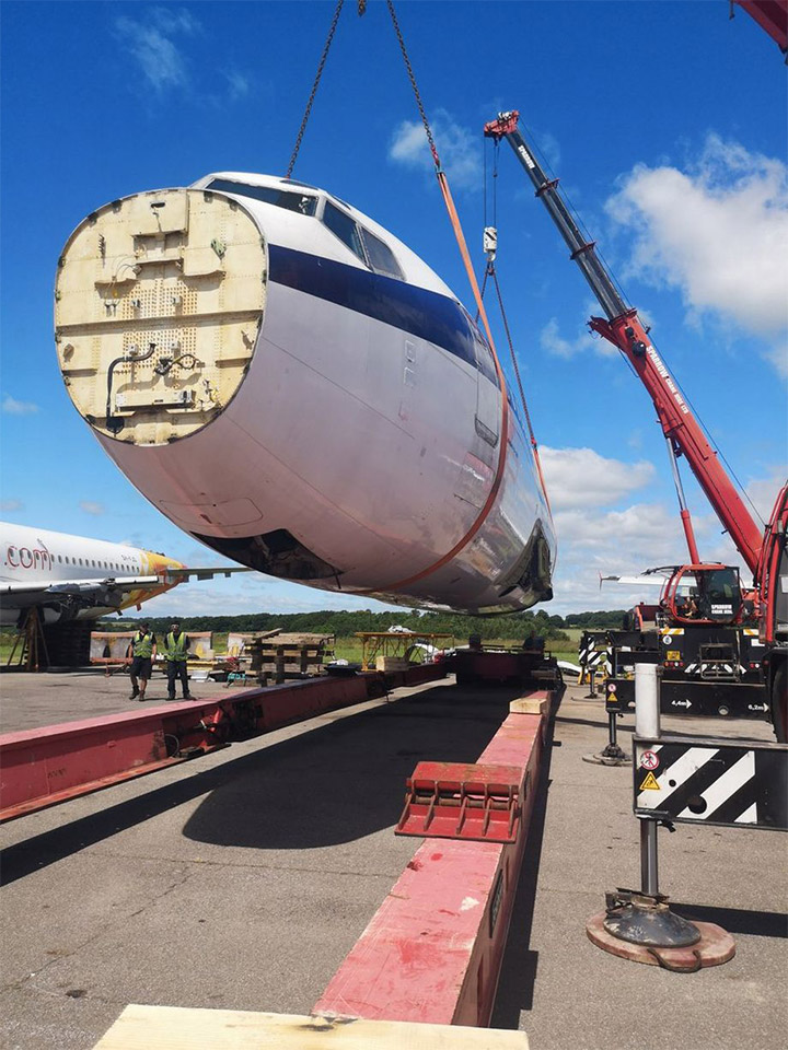 crane lift Boeing plane