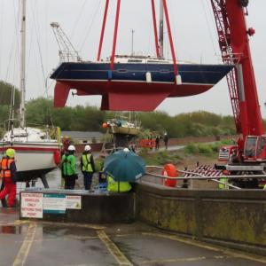 Crane lift into river Brue