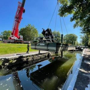 Crane lifting boat Bath