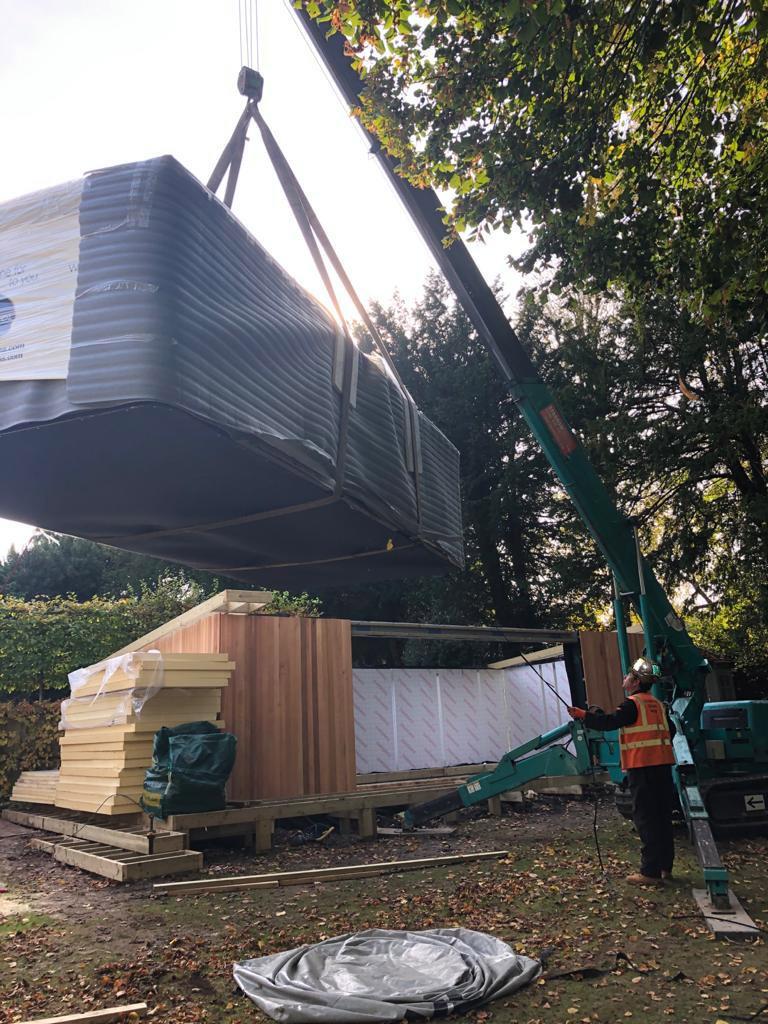 Spider crane lifts spa pool